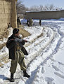 An Afghan local police (ALP) member provides security during a patrol in Baron China village in the Shah Joy district of Zabul province, Afghanistan, Jan 120131-N-CI175-035.jpg