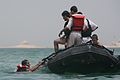 An Iraqi policeman swims toward a Zodiac patrol raft during a rescue swimming and conditioning class in Lake Quadsiyah in Haditha, Iraq, July 9, 2008 080709-M-QJ743-002.jpg