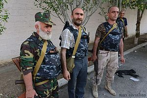 2016 Yerevan hostage crisis - Armed group leader Pavlik Manukyan (centre) and his men after seizing the police station in Yerevan.