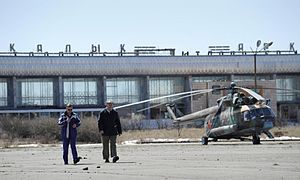 Arkalyk Airport - NASA staff wait on the apron at Arkalyk whilst a Russian helicopter is refuelled, in April 2008