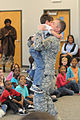 Army Lt. Col. John Palo, right, a planner for 4th Battlefield Coordination Detachment, hugs his son, Aiden Palo at Oakland Primary School, after a surprise reunion in Sumter, S.C., Feb. 3, 2012 120203-A-SF123-001.jpg