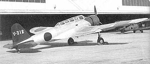 Nakajima B5N - A B5N1 Kate parked in front of a hangar.