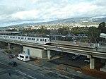 BART train at Coliseum station seen from OAC, November 2014.jpg