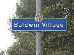 Street sign marking the border of the Baldwin Village neighborhood, located at the intersection of Obama Boulevard and Martin Luther King Jr. Boulevard