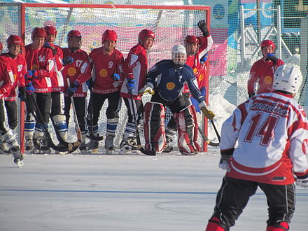 Bandy: Kyrgyzstan in red against Japan Bandy 2012. KYR - JPN.JPG