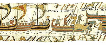 Landing in England scene from the Bayeux Tapestry, depicting ships coming in and horses landing BayeuxTapestryScene39.jpg