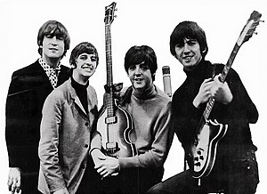 Band (rock and pop) - The Beatles were a four-piece rock band. They are pictured here in 1965, celebrating their Grammy win.