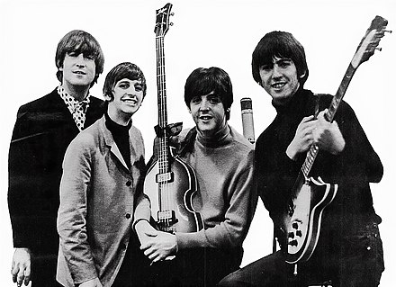 The Beatles in 1964, showing George Harrison with his original style 1963 Rickenbacker 360 12 string Beatles ad 1965 just the beatles crop.jpg