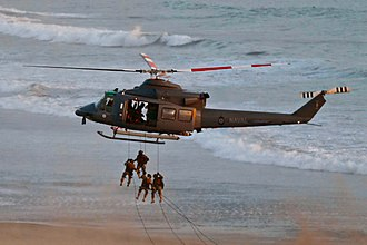 Peruvian Navy - AVINAV Bell AB-212 with fast-roping Marines