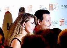 Amber Heard e l'allora marito Johnny Depp nel 2015 al Toronto Film Festival per l'anteprima di Black Mass - L'ultimo gangster