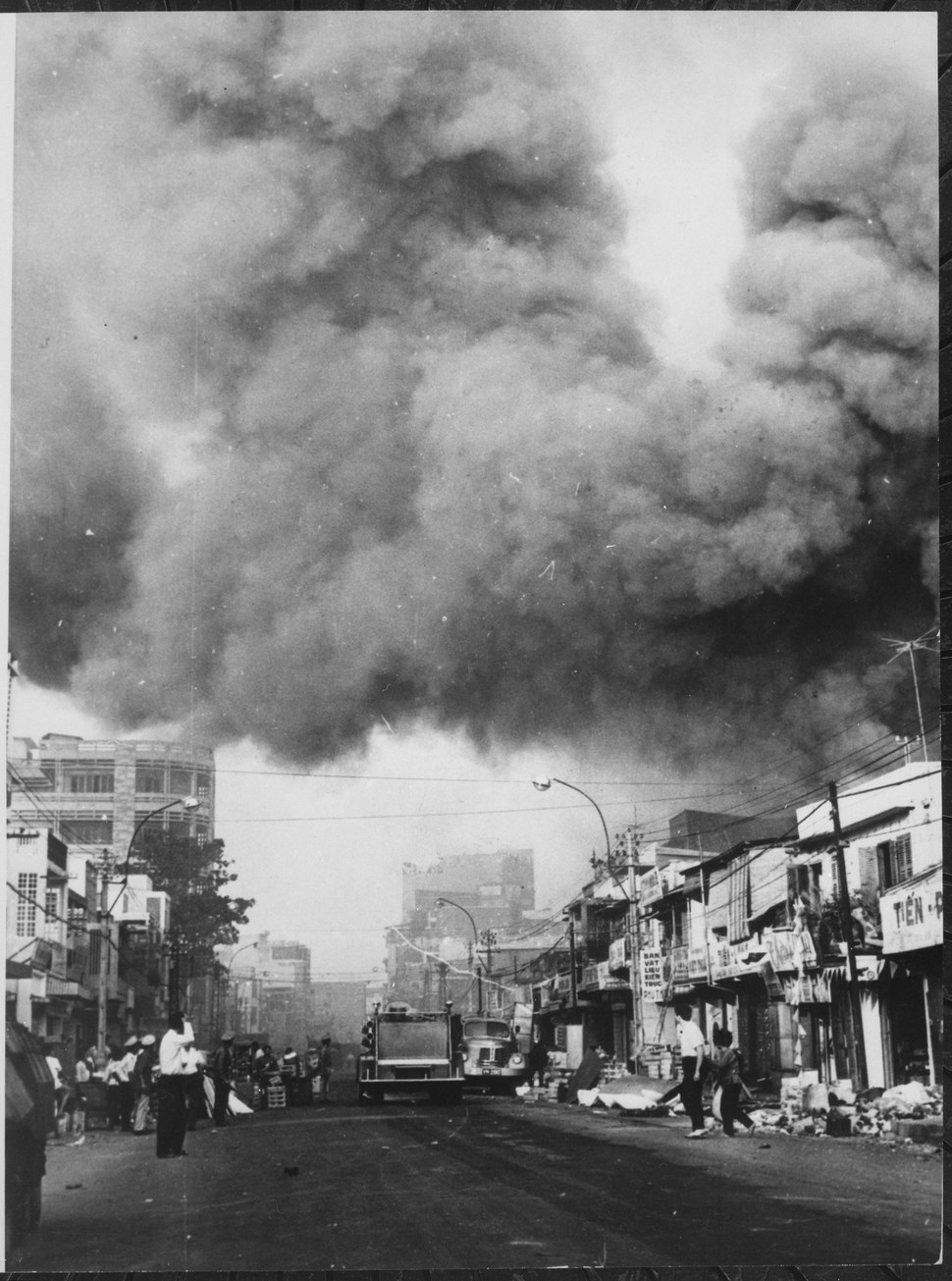 Black smoke covers areas of the capital city and fire trucks rush to the scenes of fires set during attacks by the Viet - NARA - 541874