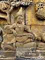 Borobudur - Divyavadana - 009 E, Sudhana is joined by Pancika and the Yaksas (detail 3) (11703742684).jpg