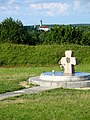 Boy playing football at the site of ancient settlement 'Zamečak' in Zaslaŭje. The cross in honour of 1000 years of Orthodoxy in Belarus - panoramio.jpg