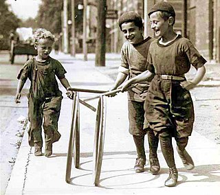 IMAGE(http://upload.wikimedia.org/wikipedia/commons/thumb/9/9f/Boys_with_hoops_on_Chesnut_Street.jpg/320px-Boys_with_hoops_on_Chesnut_Street.jpg)