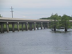 Concrete bridge carries traffic on Louisiana State Highway 9 over Black Lake near Creston.