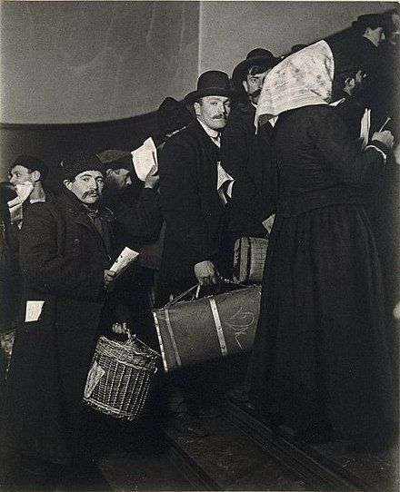 Arrivial, circa 1908 (photo by Lewis Hine) Brooklyn Museum - Climbing into the Promised Land Ellis Island - Lewis Wickes Hine.jpg