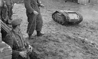 Goliath tracked mine - German soldiers with a Goliath and its remote control, Russia (April 1944)
