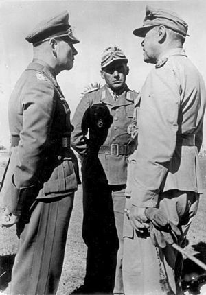 Albert Kesselring - North Africa, February 1942. Kesselring (right) meets with Erwin Rommel (left) and Fritz Bayerlein of the Afrika Korps.