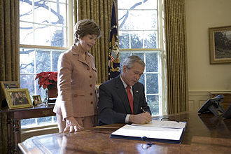 Ryan White CARE Act - President Bush signs the Ryan White HIV/AIDS Treatment Modernization Act of 2006, in the Oval Office, December 19, 2006.