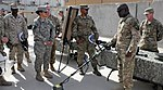 CSM Hill examines enabler equipment at the CSM Conference DVIDS454593.jpg