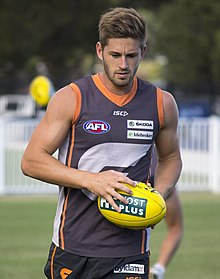 Callan Ward doing a light training run at Robertson Oval.jpg
