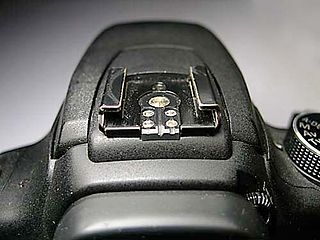 Hot shoe mounting point on the top of a camera