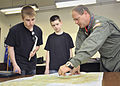 Capt. Brenden Shower shows CAP cadets a flight path in Japan.JPG