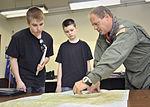 Capt. Brenden Shower shows CAP cadets a flight path in Japan.JPG