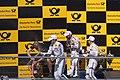 Champagne on podium (27794437222).jpg
