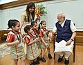 Children tying 'Rakhi' on the Prime Minister, Shri Narendra Modi's wrist, on the occasion of 'Raksha Bandhan', in New Delhi on August 07, 2017 (4).jpg