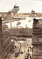 Circular Quay circa 1930s showing trams, six K-class ferries, and Sydney Harbour Bridge under construction circa 1930.jpg