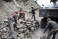 Clearing rocks after a landslide (3803035281).jpg