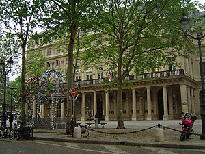 "Place Colette with the ""Kiosque des noctambules"" (left). The building in the background is the Comédie-Française"
