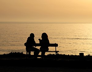 Talking in the evening. Example of a contre-jour