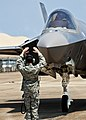 Crew chief marshals new F-35 to a stop at Eglin AFB.jpg