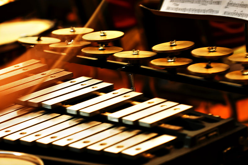 A glockenspiel (German pronunciation: [ˈɡlɔkənˌʃpiːl], glocken:bells and spiel:play) is a percussion instrument composed of a set of tuned keys arranged in the fashion of the keyboard of a piano. In this way, it is similar to the xylophone; however, the xylophone's bars are made of wood, while the glockenspiel's are metal plates or tubes, thus making it a metallophone. The glockenspiel, moreover, is usually smaller and higher in pitch