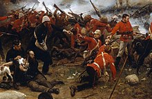 A painting of the battle at Rorke's Drift, showing wounded British soldiers being helped behind a firing line of soldiers.