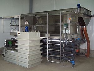 Dissolved air flotation - DAF unit with a capacity of 20 m³/h, visible also: flocculant preparation station and pipe flocculator