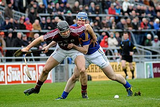 David Collins (hurler) - David Collins of Galway holds off Tipperary's Eoin Kelly in the 2014 National Hurling League
