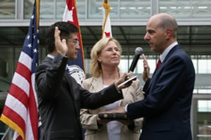 Under Secretary of Commerce for Intellectual Property - David Kappos (right) being sworn in as Under Secretary of Commerce for Intellectual Property and USPTO Director, by Secretary of Commerce Gary Locke, as Kappos's wife, Leslie, holds the bible, August 13, 2009