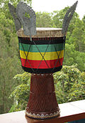 Djembe decorated with folded-over skin, sege sege, rope wrap, and metalwork