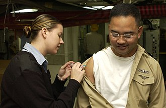 Influenza vaccine - U.S. Navy crew member receiving an influenza vaccination