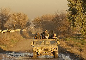 Albanian Armed Forces - Albanian soldiers conduct a joint patrol with U.S. soldiers in Iraq on January 13, 2005.