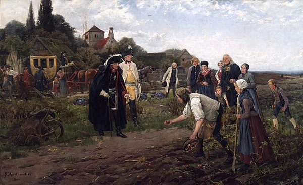 King Frederick the Great of Prussia, a potato proponent, inspects an early harvest. (Robert Warthmuller, 1886) Der Konig uberall2.JPG