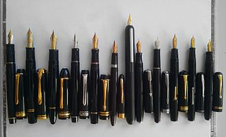 Fountain pen - Various contemporary and vintage fountain pens (left to right) Pilot Justus 95, Pelikan Souverän M1000, Montblanc Meisterstück 149, Pilot Heritage 912, Parker Duofold Centennial, Sheaffer Snorkel Admiral, Lamy Dialog 3, Welty, Parker Sonnet, Conway Stewart 55, Waterman Thorobred, Mabie Todd Swan 3220
