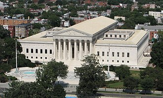 United States Supreme Court Building - View of Supreme Court Building from United States Capitol dome.  At Cass Gilbert's request, A. Hall and Sons Terra Cotta of Perth Amboy, New Jersey created the terra cotta roof for the building housing the nation's highest court.