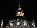 Dome of St. Peter and statues at night.jpg