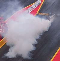 Example of a burn-out before staging at Hockenheimring, Germany. Note the amount of smoke.