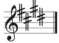 E major key signature on treble clef.png