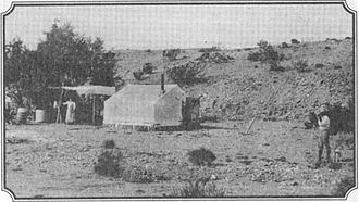 Josephine Earp - Wyatt Earp's camp, tent and ramada near Vidal, California and Wyatt's mining operations. Sadie is at left, Wyatt is on the right with his dog.